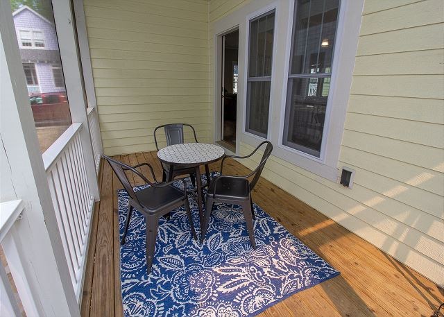 Fully screened in porch off the dining room