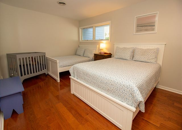 Second level bedroom with full and twin bed