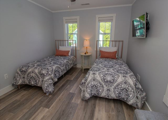 Second floor bedroom with two twin beds with attached full bath