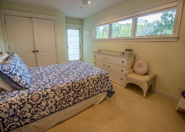 Second level bedroom #2- queen bed with attached private deck an