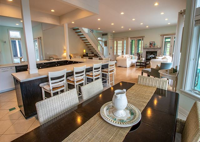 Main level open kitchen, dining and sitting room with fireplace