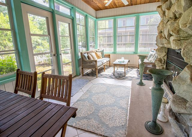 Main level 4 seasons porch with fireplace
