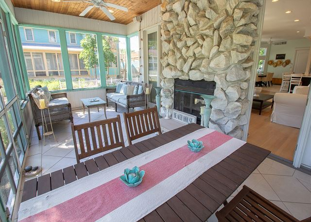 Screened in patio with fireplace