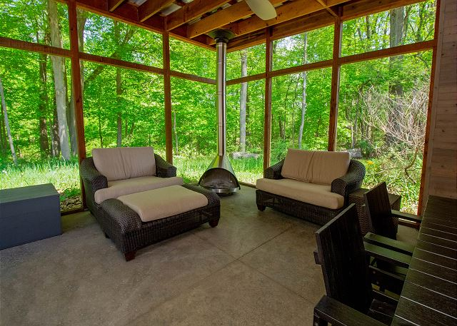 Screened in porch with wood fire place