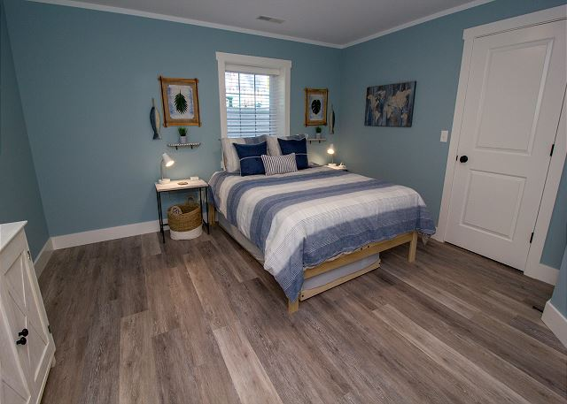 Basement bedroom with queen bed and twin trundle bed