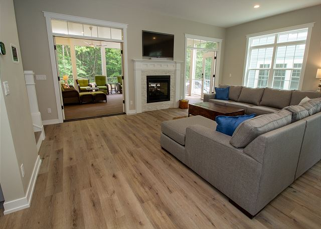 living room opens to large screening in porch for more entertain