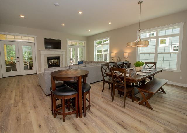 Main level open living room and dining with a double sided gas f