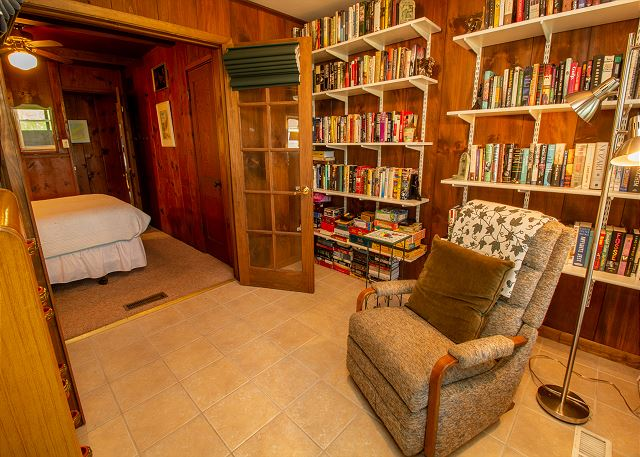 Library attached to bedroom with queen bed
