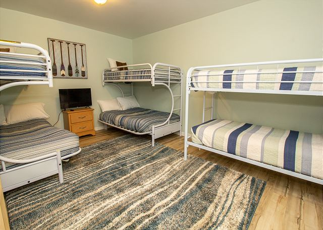Ground level bunk room with 2 queen over twin and twin bunks