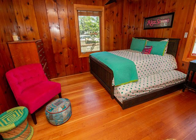 Main level queen bed with twin trundle