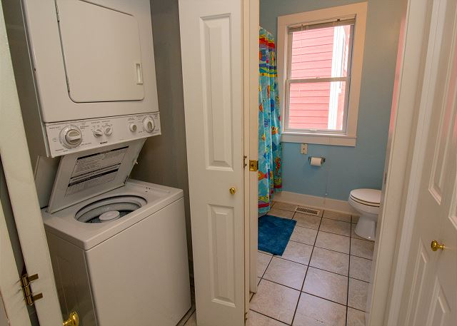 Stacking Kenmore washer/dryer and entrance to full bathroom