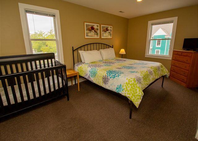 Second floor queen bed with crib
