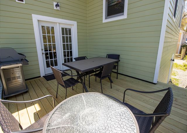 Back deck, off second floor landing with grill and seating for 6