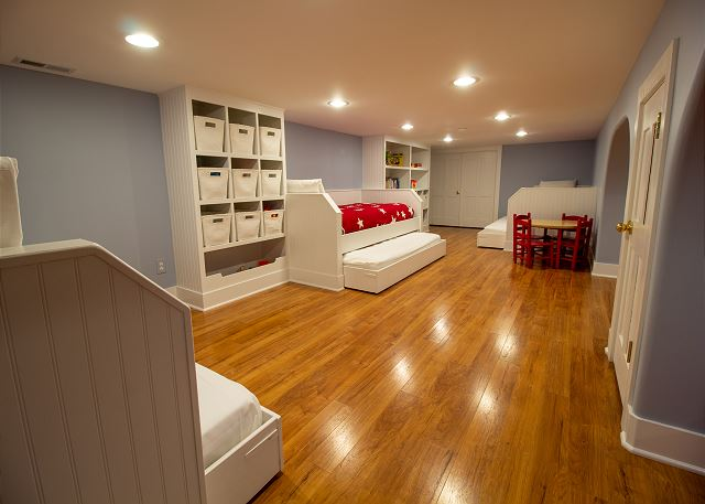 Basement three twin beds with trundles