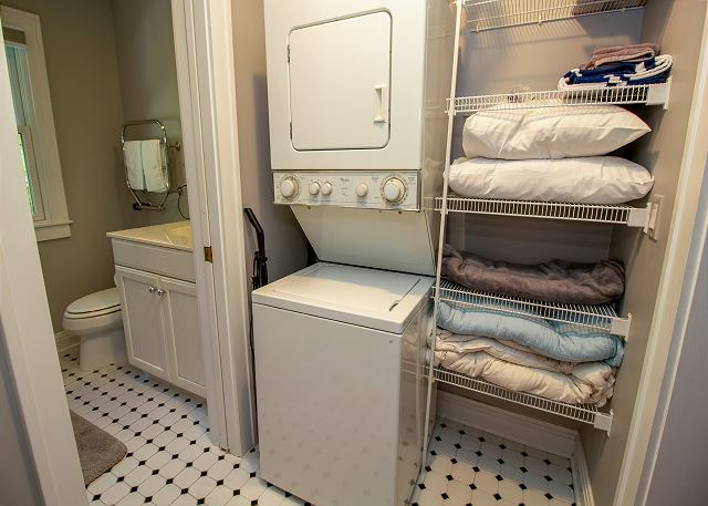 Guest House walk through closet with washer and dryer to the ful