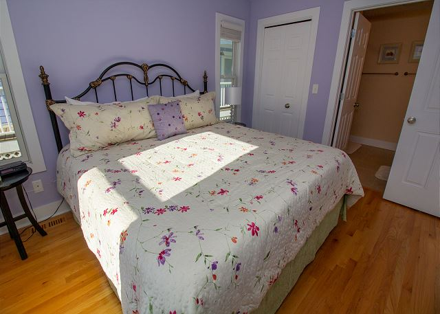 Main level queen bed with attached 3/4 bathroom