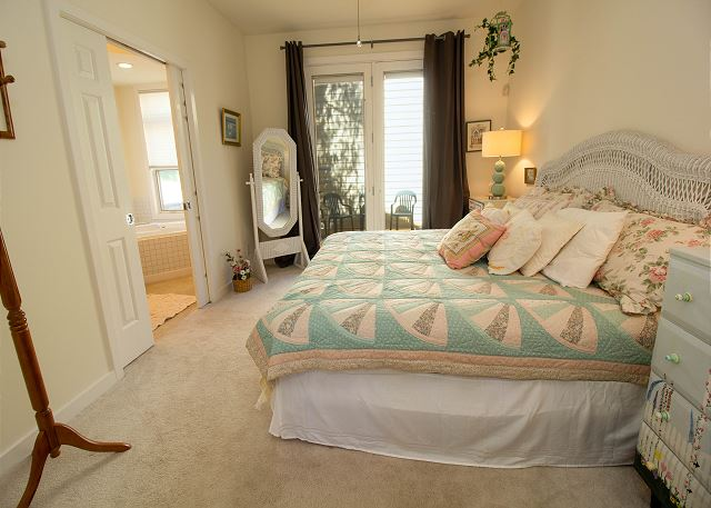 Main level master king bedroom with attached full bathroom