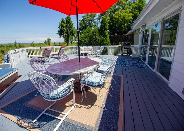 Back deck with gas grill and view of Lake Michigan