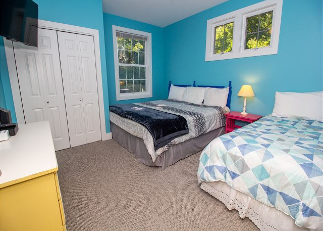 Main level king and twin bedroom with attached bath