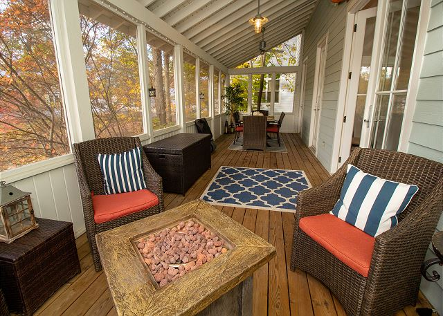 Main level screened in porch with extra dining space