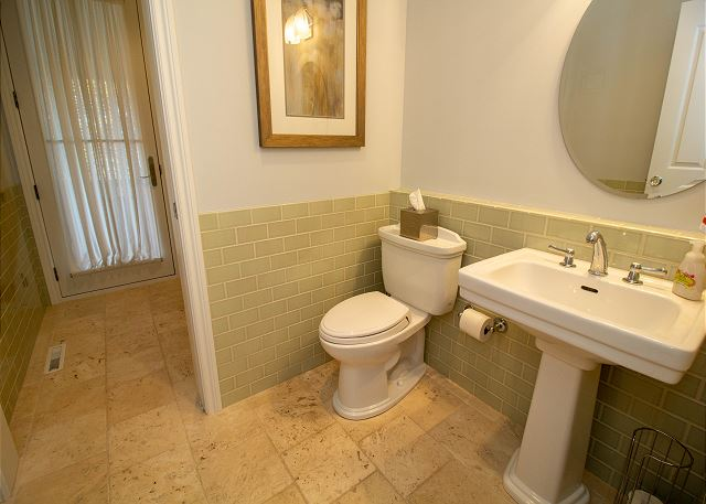 Main level full bathroom with separate bathtub
