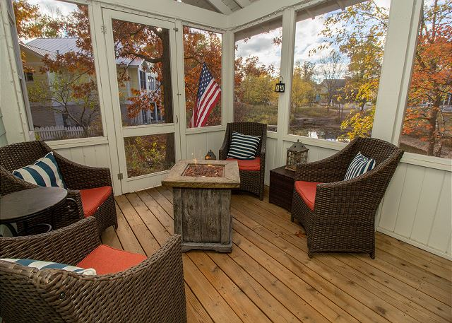 main level screened in porch with gas fire pit