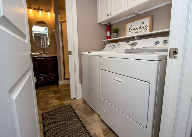 Main Level laundry room off the kitchen with attach 3/4 bathroom