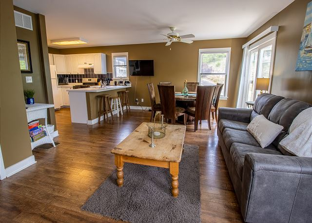 Guest house main level open dining and living room with full kit