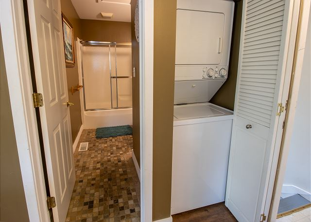 Guest house main level full bathroom and stacking washer and dry