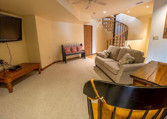 Basement living room with queen sleeper sofa