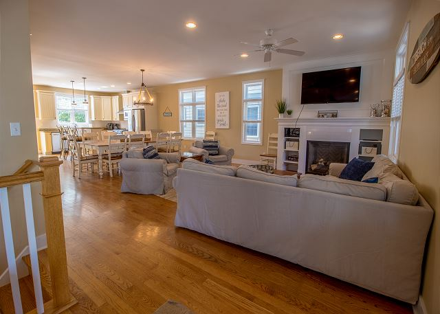 Main level open living room with dining and kitchen