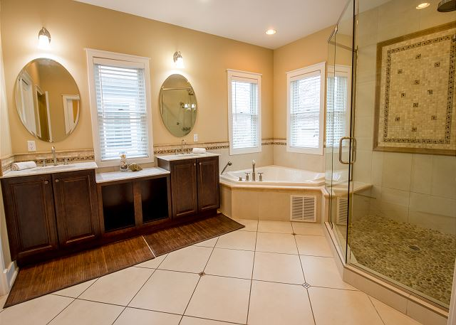 Attached master bath with walking shower and tub
