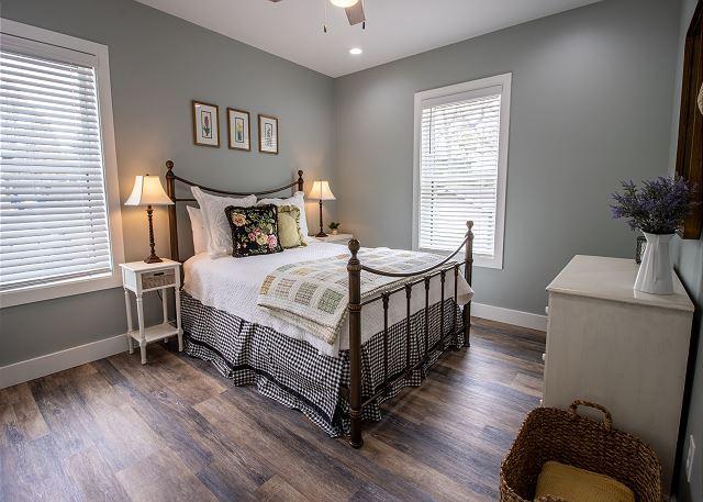 Main level bedroom 1 with queen bed