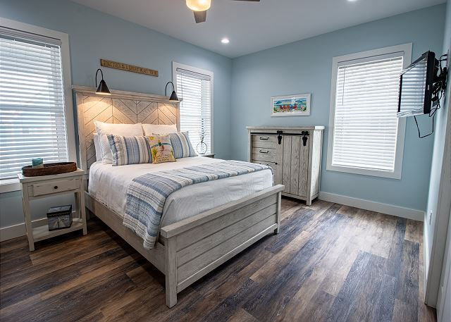 Main level bedroom 2 with queen bed with attached full bath