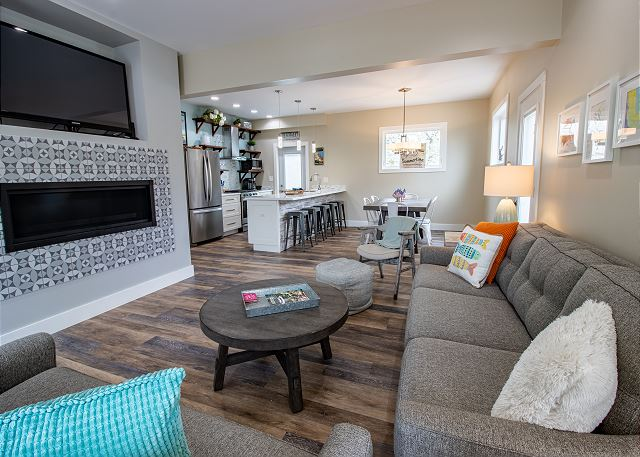 Main level living room, dining and kitchen