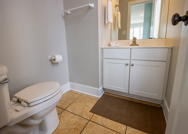 Main Level powder room off the kitchen