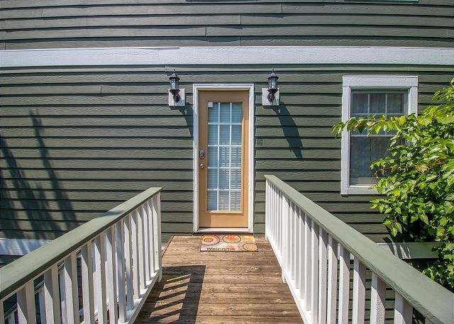 Guest house second level catwalk entrance from main house