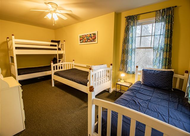 Bedroom #1: 2 twin beds and 1 twin bunk bed