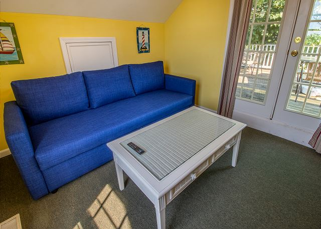 Guest house second level with full sleeper sofa, TV and top deck