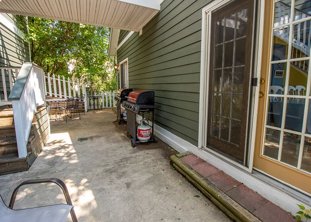 Second/main level back patio with 2 gas grills