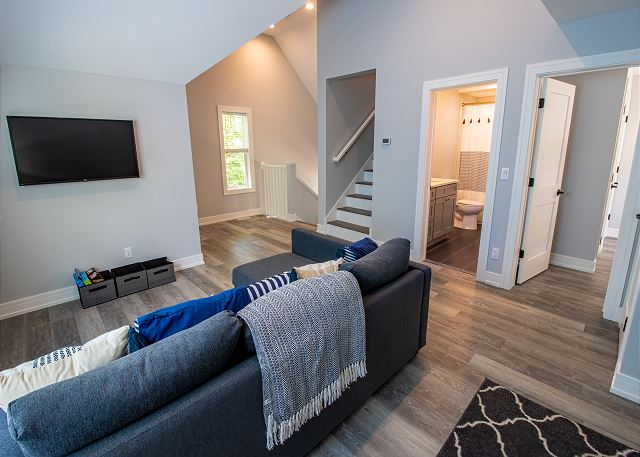 Second Level landing with sleeper sofa and a daybed that opens t