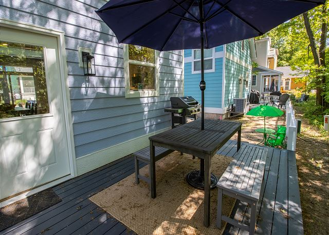 Back deck outdoor seating with gas grill