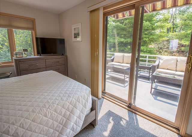 Main level bedroom #1 - queen bed with private deck