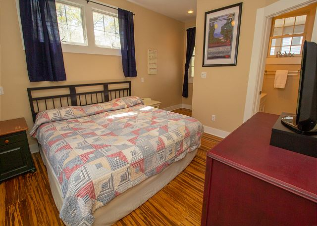 Main floor King bedroom with attached 3/4 bathroom