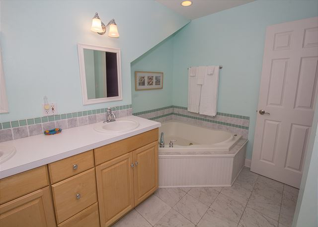 Attached to the purple room is this large bathroom with corner t
