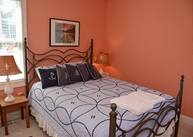 Bright main level Queen bedroom with attached Jack and Jill full