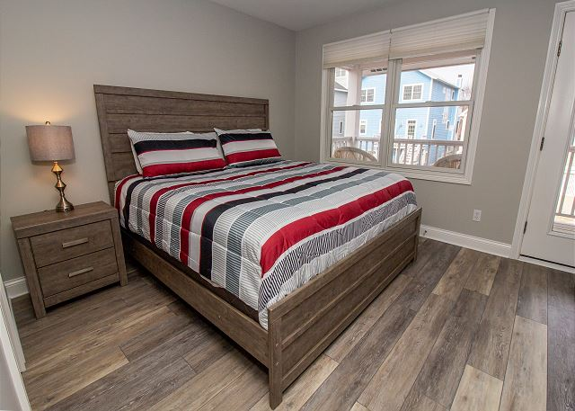 Second level master bedroom with king bed and attached full bath