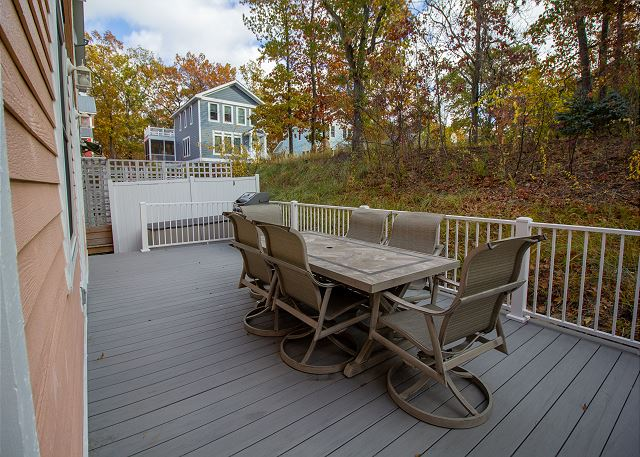 Back deck with seating for 6 and a grill