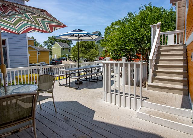 Back decking with dining and guest house, Jester entrance