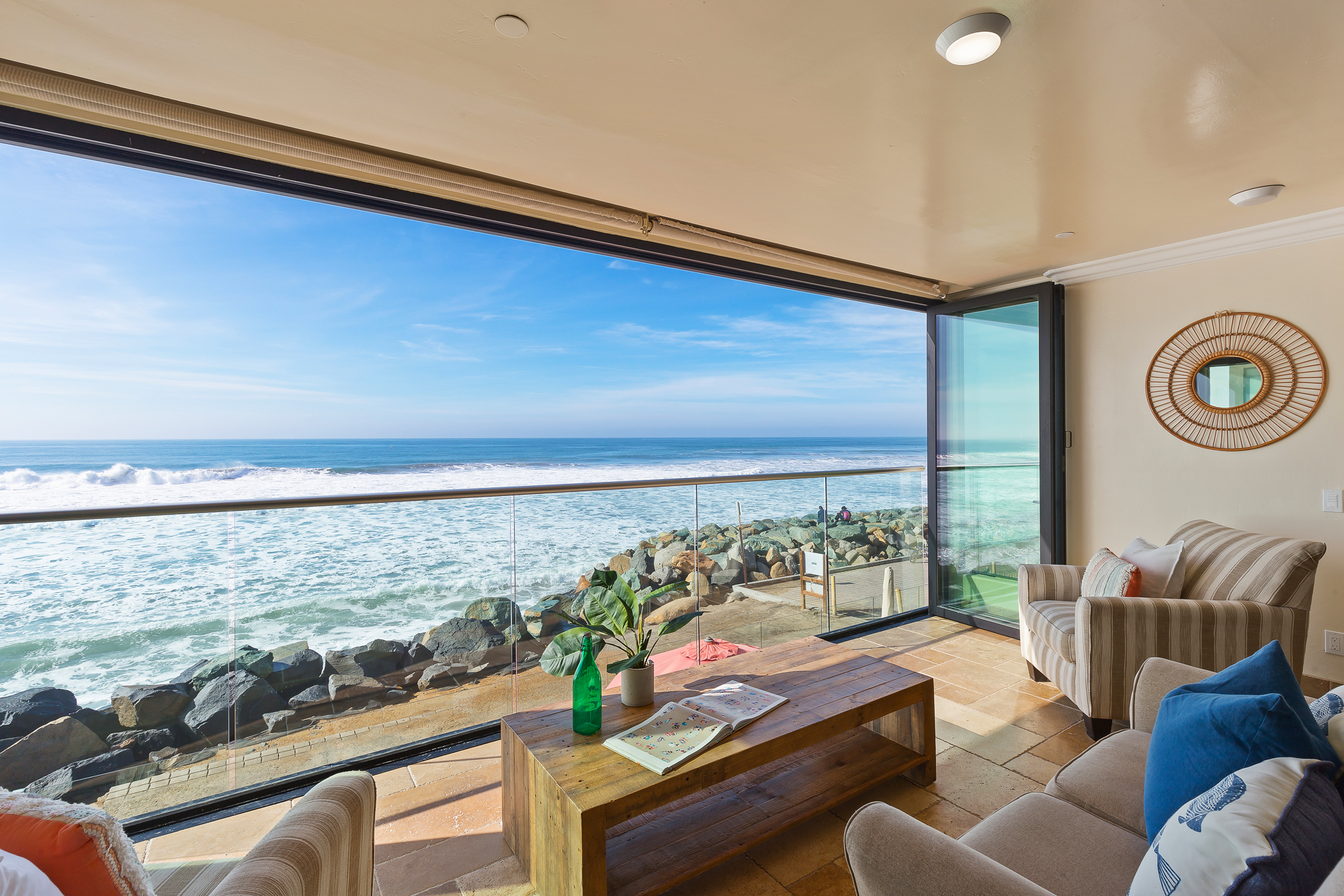 Oceanside Home with Deck | Beachfront Only Vacation Rentals